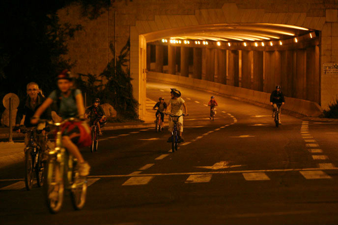 Israelis ride their bicycles on the empty streets of Jerusalem on Yom Kippur. (Miriam Alster/FLASH90)