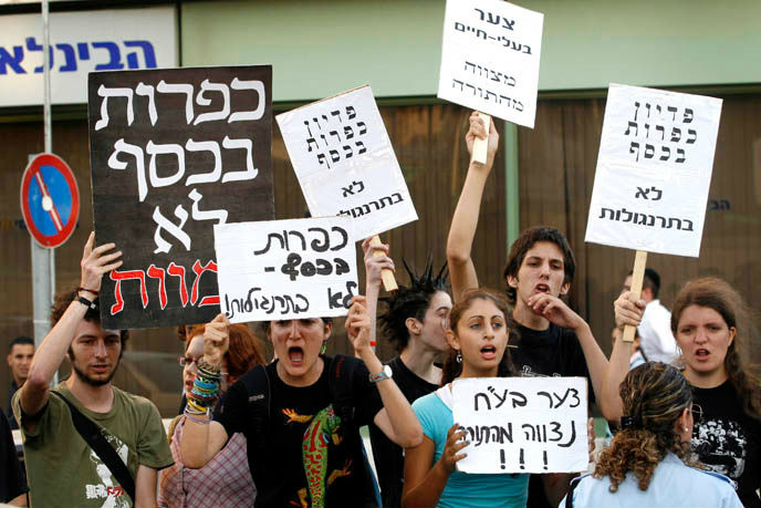 Animal rights protesters outside Mahane Yehuda Market gather to demonstrate against the killing of chickens as part of the Kaparot ritual, performed the day before Yom Kippur. Some believe that sins from the past year can be transferred to a chicken by reciting a blessing and waving the animal overhead. (Michal Fattal/Flash90)