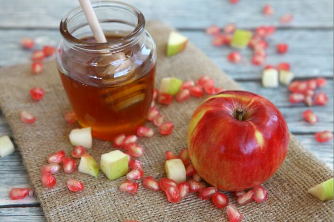 Honey, apples and pomegranate are found on most Jewish tables for Rosh Hashanah. Photo by Liron Almog/FLASH90