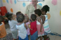 cap 1: 'A moment of kindness' with kids at Felicia's daycare. Photo by Abigail Klein Leichman