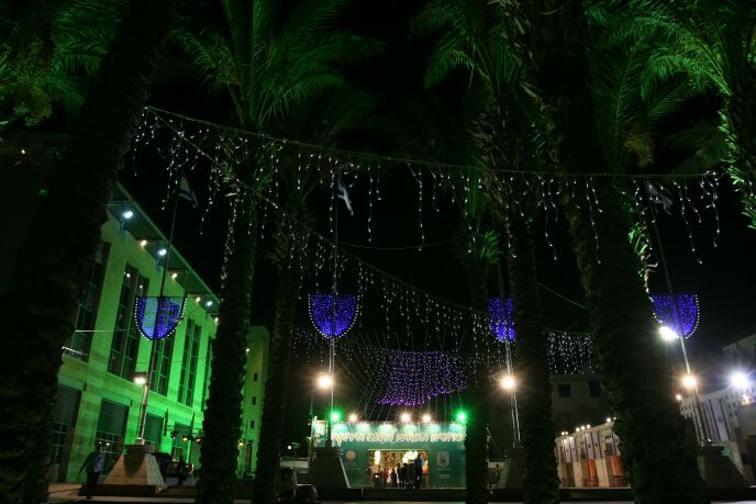 Safra Square sukkah at night. Photo by Anna Kaplan/FLASH90
