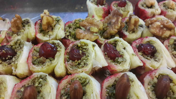 Nuts and dates are stuffed into savory pastries. Photo by Adnan Kvishi