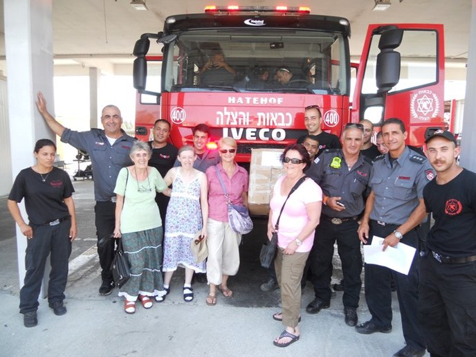 From left, Vicky Savitz, Sara Burrows, Orli Avior and Karen Rafael brought care packages to Ashkelon firefighters. Photo courtesy of June Narunsky.