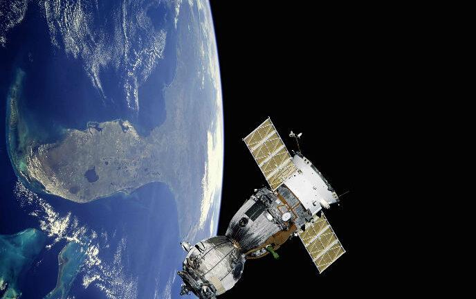 A satellite orbiting earth. Photo by www.shutterstock.com