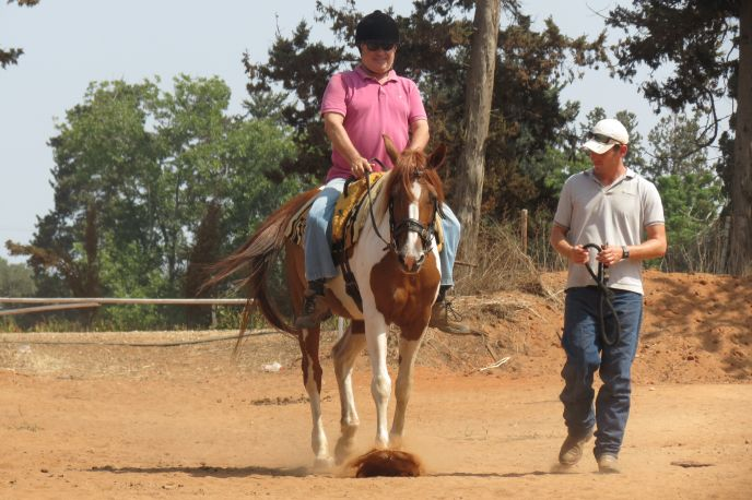 Yossi Shemtov riding at INTRA.