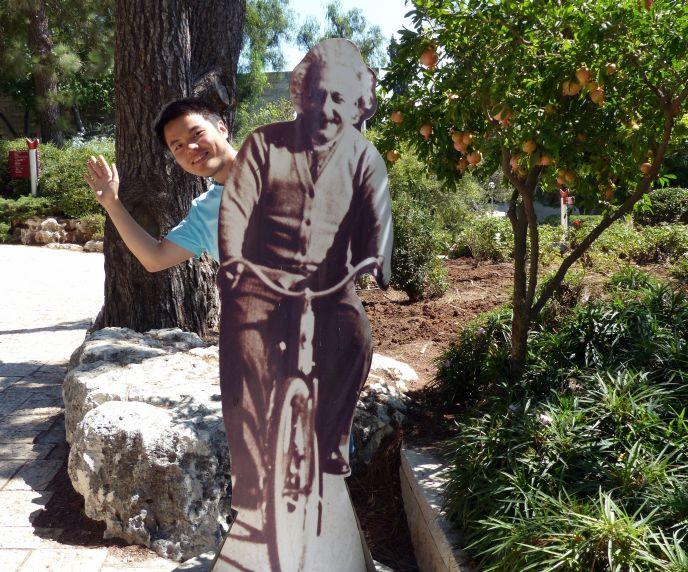 Lechao Tang behind the Albert Einstein statue at the Mount Scopus campus of the Hebrew University of Jerusalem. (Photo: Hebrew University)