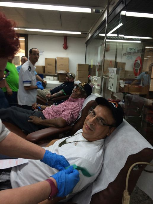 From foreground: Isaac, Juan and Anthony donating blood at Magen David Adom in Tel Hashomer. Photo by Judy Schaffer