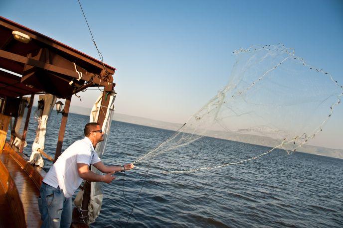Casting a net on the Kinneret. Image via Shutterstock.com