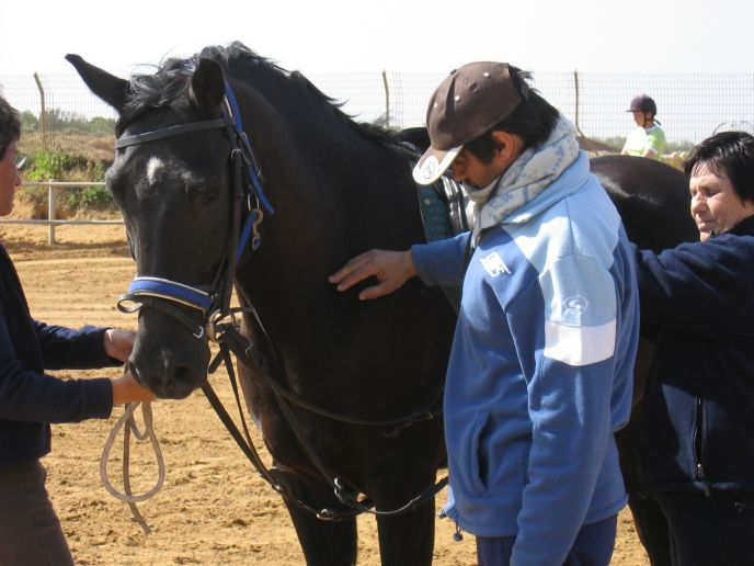 Anita Shkedi, right, with a terror victim who flourished after two years of equine therapy.