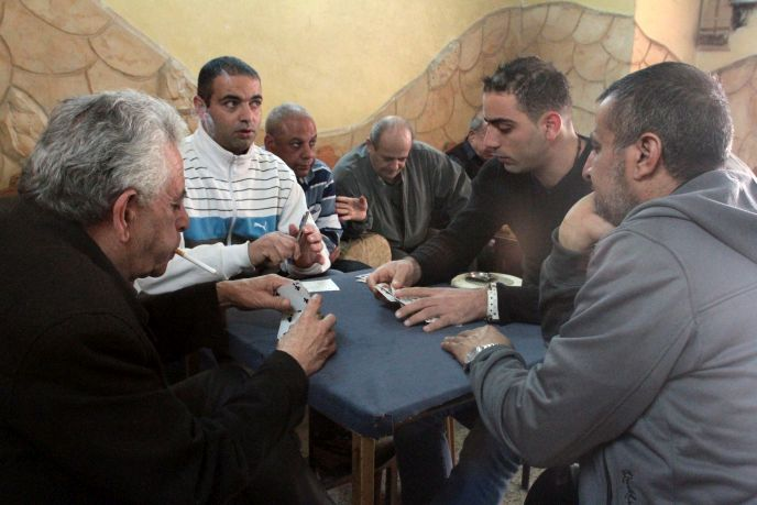 Arab customers play cards at Abu Salem's Coffee House in Nazareth. Photo by Flash90.