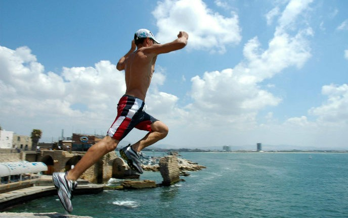 Taking the plunge in Akko. Photo by Shay Levy/FLASH90.