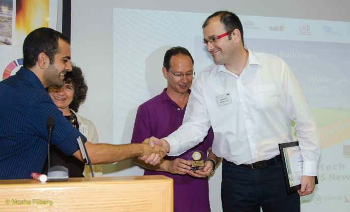 Noam Novich of AutoAgronom accepting the CleanTech Open award in Tel Aviv. Photo by Moshe Filberg.