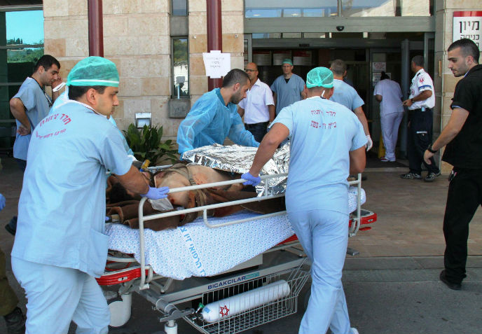 A wounded Syrian is brought to Ziv Medical Center for treatment.