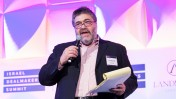 Jon Medved, founder of OurCrowd, speaking at the Israel Dealmakers Summit in New York in March 2014. Photo courtesy.