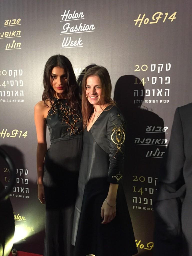 Top model Shani Zigron, left, and Sharon Tal at Holon Fashion Week wearing Maskit fashions.