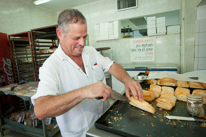 An Israeli chef prepares bourekas at a restaurant in Beersheva. (Photo by Moshe Shai/FLASH90)