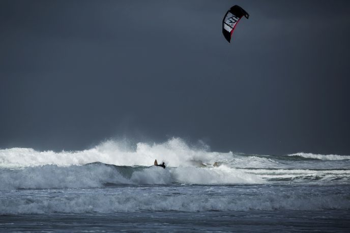 Kite surfing off the coast of Tel Aviv last January, as winds gusted to 45 kilometers per hour. (Matanya Tausig/FLASH90)