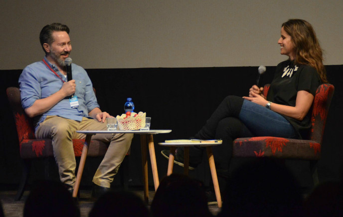 Noa Tishby interviewing Swedish comedy writer Josef Sterzenbach at Comedy for a Change in Jerusalem. Photo by Sharon Altshul