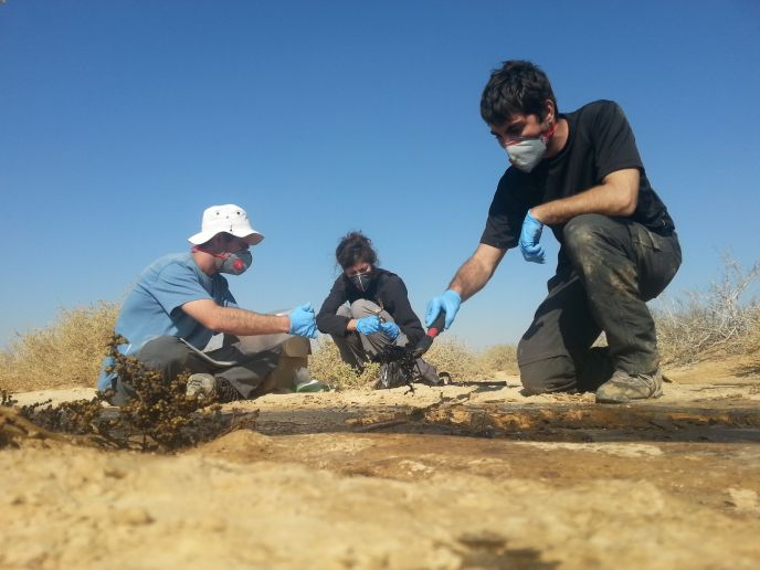 A Technion student measures a stream of crude oil.