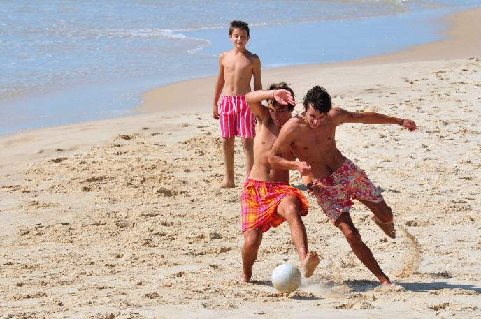 Join a pickup game at the beach. Image via Shutterstock.com