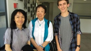 Iddo Gino showing Taiwanese journalists around Haifa's Hebrew Reali School in 2013.