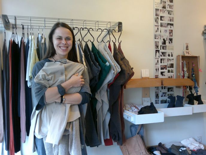 Bash with one of her favorite items, a washed beige jacket with hand-knit lining. Photo by Abigail Klein Leichman