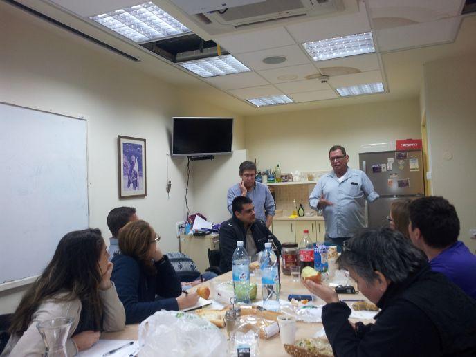 Visitors listening to Maozya Segal, head of social affairs for the Hof Ashkelon Regional Council.