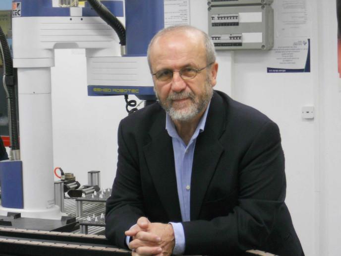 Prof. Zvi Shiller in his robotics lab at Ariel University.