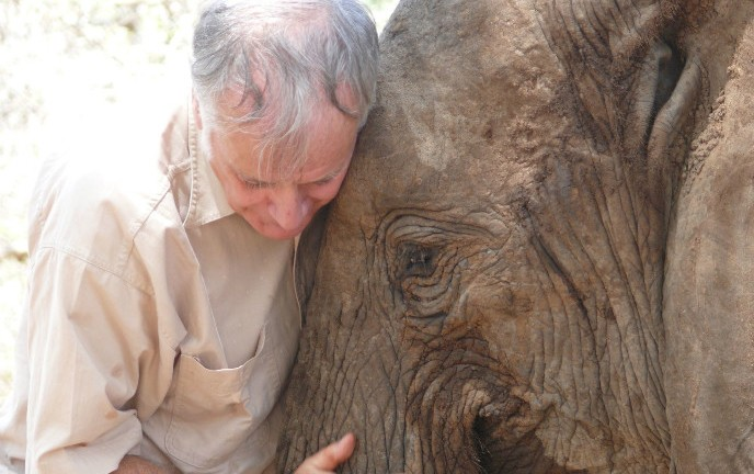 Bill Clark with Wendi, an elephant orphaned by poachers a day after her birth in Meru National Park, Kenya, 15 years ago. She was adopted by the Sheldrick elephant orphanage and successfully reintroduced to the wild. Photo by Nir Kalron