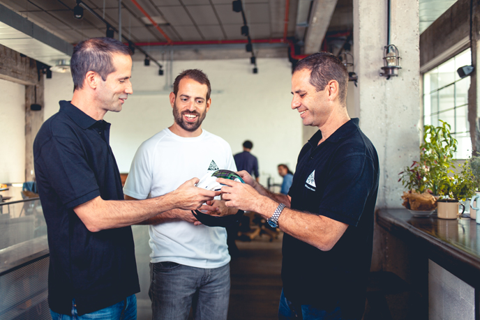 Founders Ori Kotek, Zur Erez and Alon Getz with their prototype goggles.