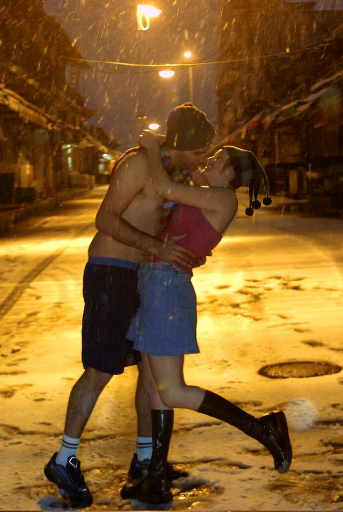 Love will keep you warm. A couple kiss in the snow at Machane Yehuda in Jerusalem, wearing little but their love. Photo by Flash90