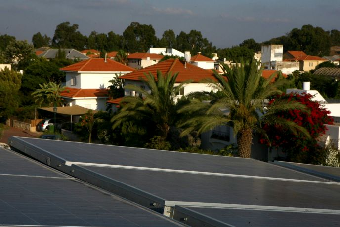 Solar panels on the roof of a home in Israel. Photo by Flash90.