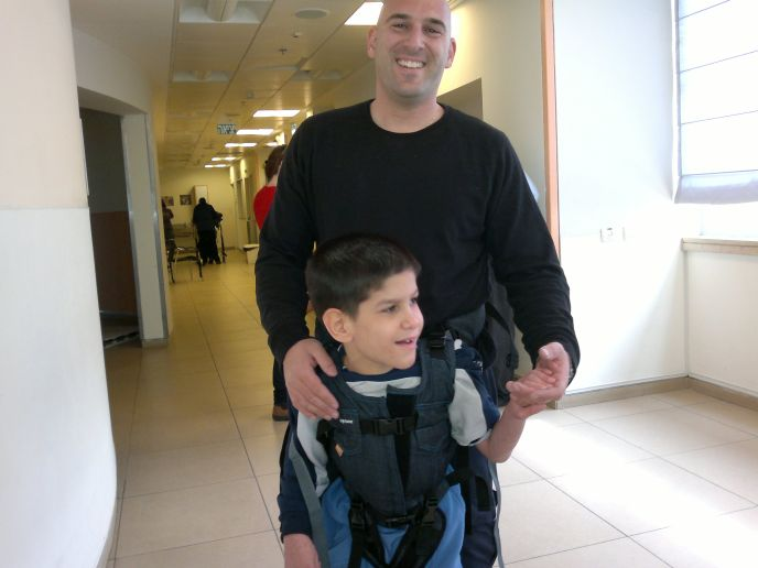 Officer Nir using an Upsee harness to train with his ALEH partner.