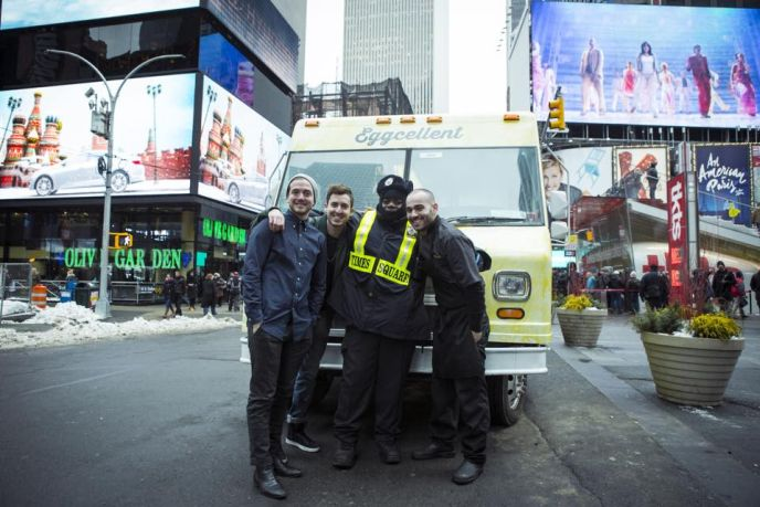 A Times Square police officer shows a little love to the Shuka Team.