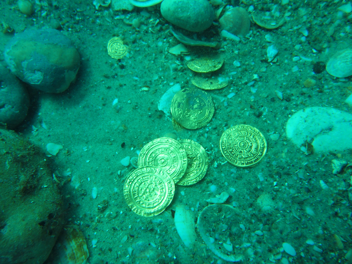 "Divers first thought the coins were remnants of a children's game but upon closer inspection realized they had found ""the real thing."" (photo: 1–2. Almost 2,000 coins were discovered on the seabed. (Photo: Kobi Sharvit, courtesy of the Israel Antiquities Authority)"
