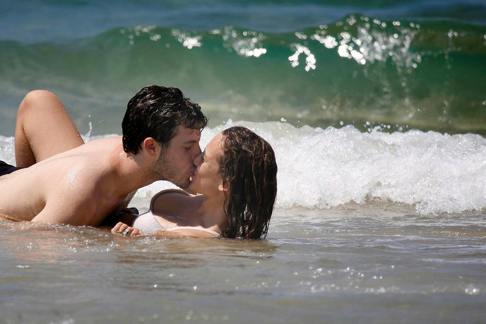 When it's hot outside, there's only one way to cool off, especially when you're young and in love.  Photo by Nati Shohat/Flash90 at Metzizm beach in Tel Aviv.