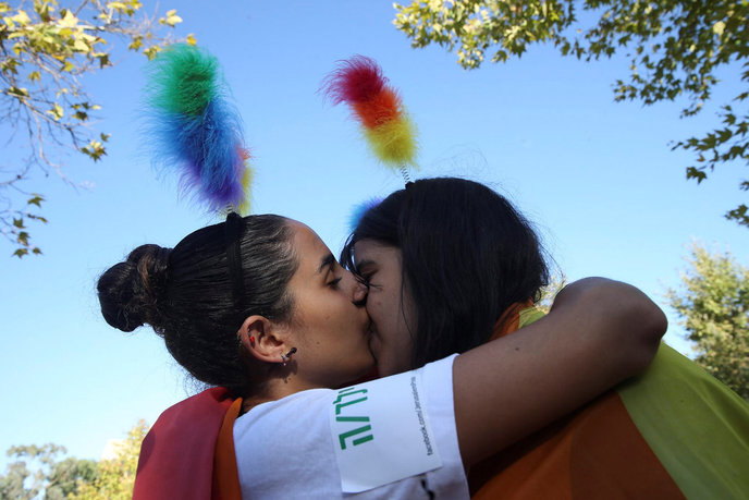 Gay pride events in Jerusalem and Tel Aviv are some of the most riotous and fun happenings of the year. A young couple attending the Jerusalem gay pride parade are swept up in the moment. Photo by Nati Shohat/Flash90