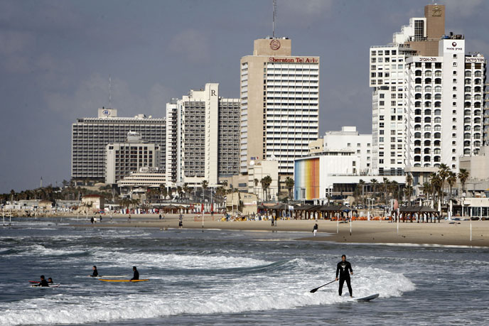 Surfers in the Mediterranean Sea, along Tel Aviv's coast. (Photo by Miriam Alster/FLASH90)