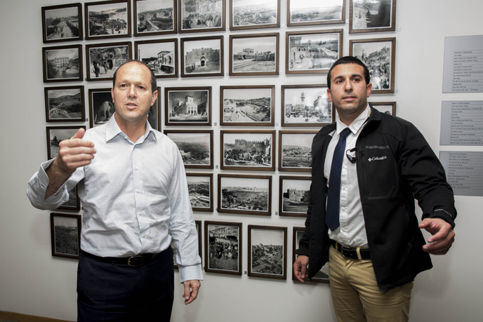 Jerusalem Mayor Nir Barkat and his security guard during a press conference at City Hall on February 22, 2015, after Barkat and his security official helped subdue a knife-wielding terrorist. Photo: Yonatan Sindel/FLASH90