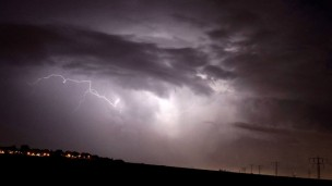 A thunder and lightning storm over Nitzan, in the south of Israel. (Photo by Edi Israel/Flash90)