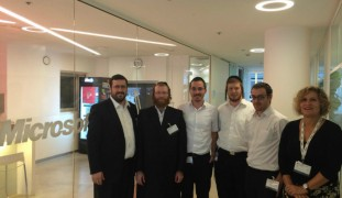 KamaTech founders Moshe Friedman and Zika Abzuk at the Microsoft R&D center, flanking four Haredi students placed by KamaTech at Microsoft, Marvel and Check Point.