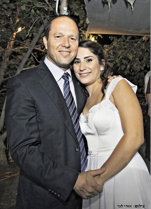 Nir Barkat with Liz Montilio, the young woman he saved 11 years ago, at her wedding in 2013. (Photo: Uri Luntz)