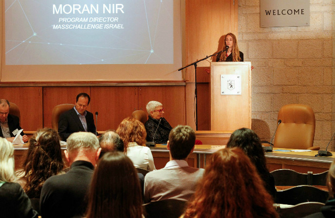 MassChallenge Israel program director Moran Nir speaking at the event at Jerusalem City Hall, with Mayor Nir Barkat and EMC VP Orna Berry in the foreground. Photo: Yaniv Yur