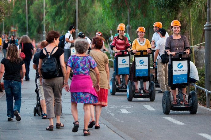 Segway riders zoom through Train Track Park. Photo by Yonatan Sindel/FLASH90