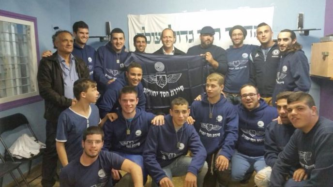 Jerusalem Mayor Nir Barkat, center, with SAHI members. Oded Weiss is fourth from right, next to Barkat; Avraham Hayon is third from right.