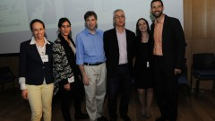 Medivizor cofounder and CEO Tal Givoly (blue shirt), flanked by mHealth Israel organizers.