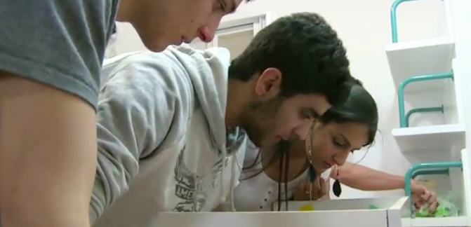High-school students try to pick a lock to secure a future in science. (Screen grab from YouTube)