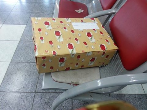 A Giant/Dwarf package waiting to get mailed in an Israeli post office.