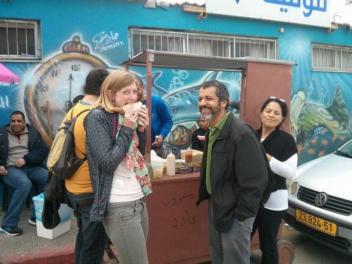 Visitors enjoying street food in town.