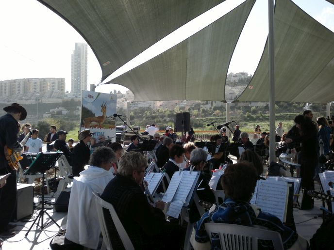 Music filled the air on opening day, and concerts are planned regularly for Gazelle Park. That's the Holyland apartment complex in the distance. (Photo: Abigail Klein Leichman)